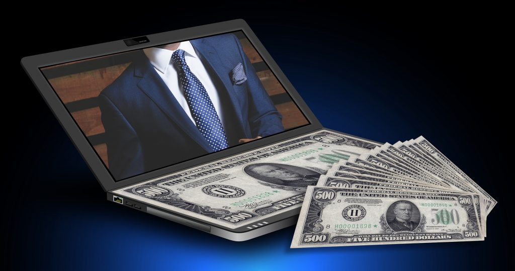 Internet marketing image of 500 dollars and a laptop.